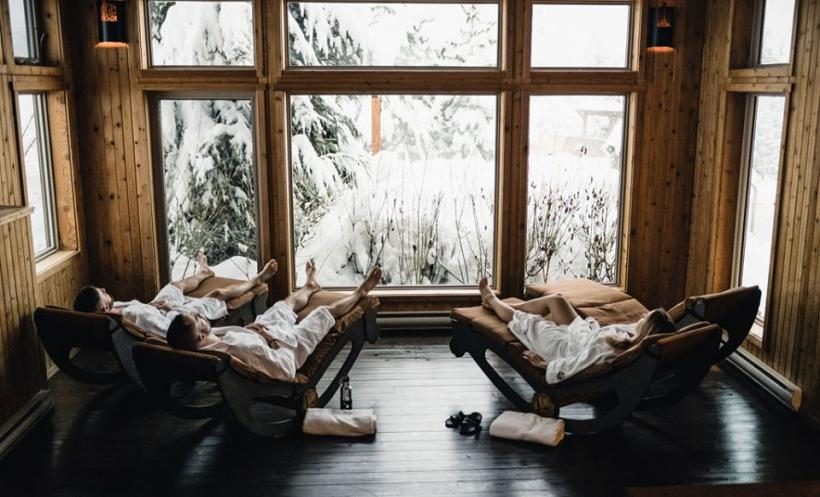 Relaxing in a solarium at Scandinave Whistler