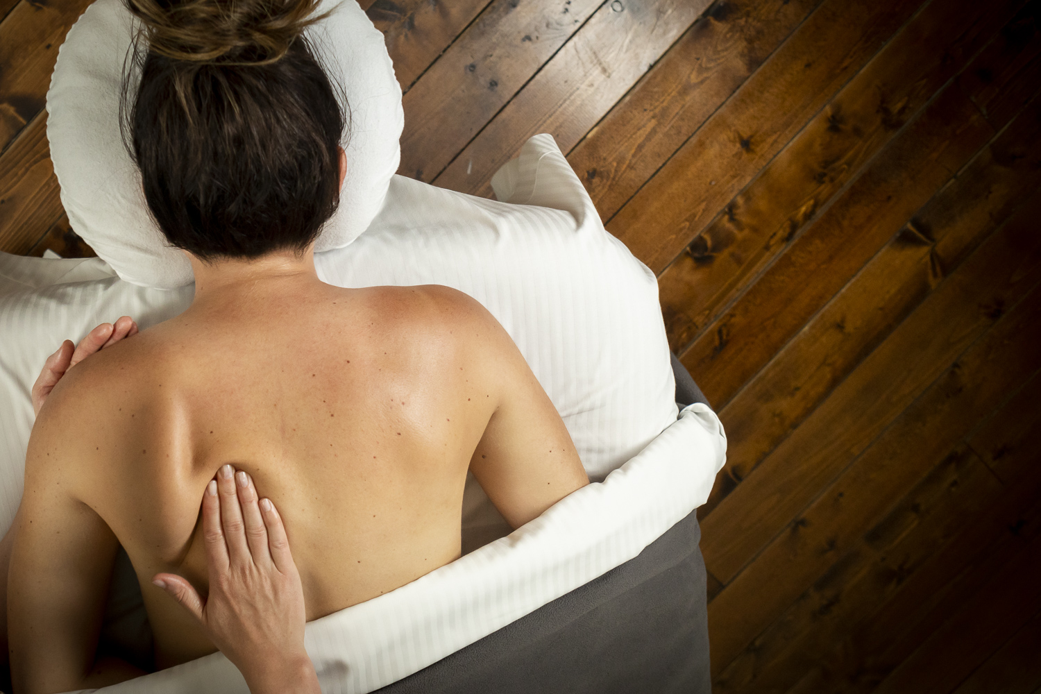 Person getting massage on back at Scandinave Spa Whistler