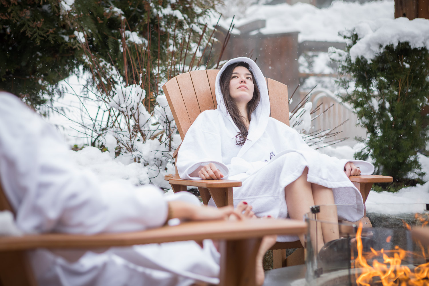 Lounging fireside at the Scandinave Spa Whistler