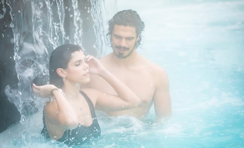 Couple in waterfall at Scandinave Spa Whistler