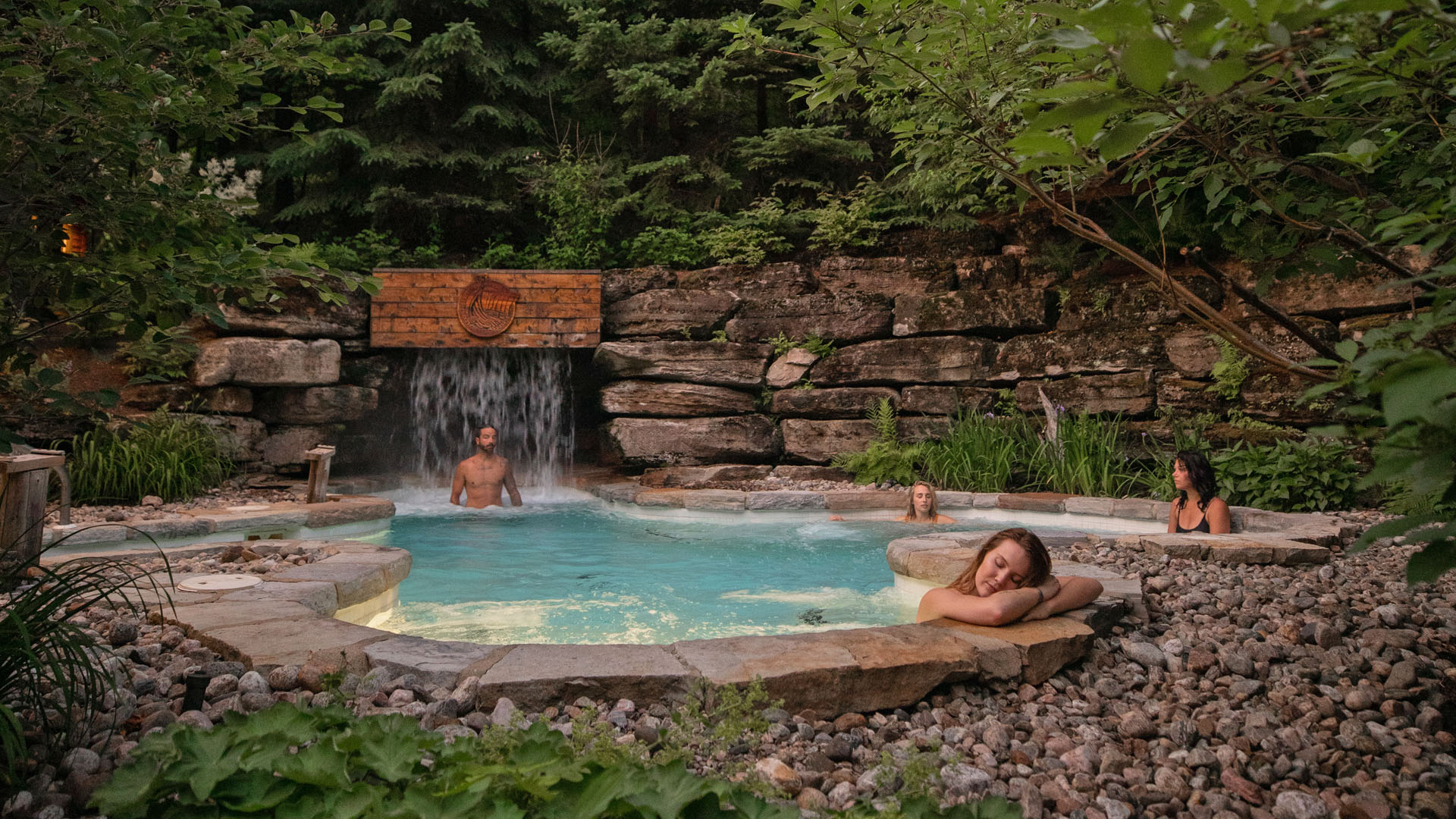 Four guests relaxing in one of the Scandinave Spa baths in Tremblant.