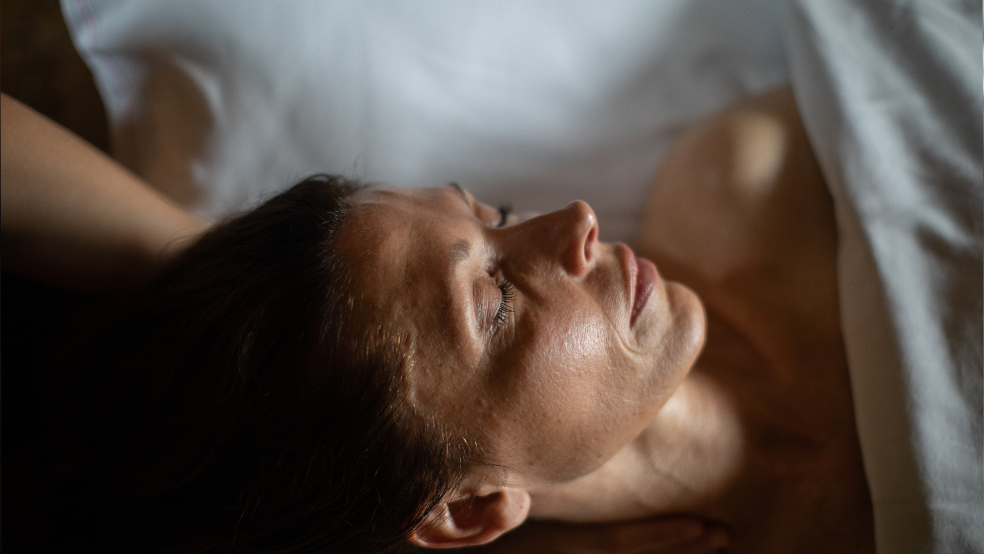 A woman relaxing in one of the Scandinave Spa Tremblant massage studios.