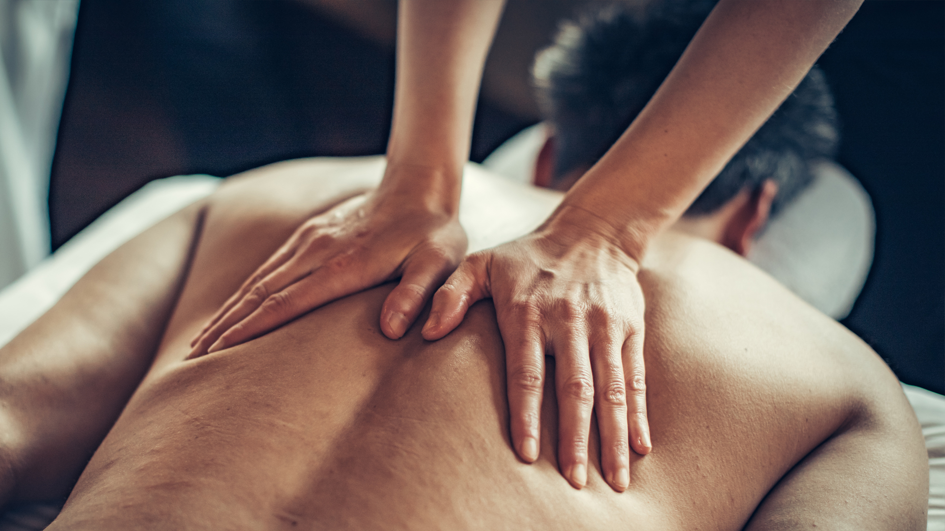 A guest receiving a massage at Scandinave Spa Mont-Tremblant.