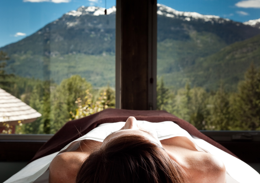 Massage with mountains in background