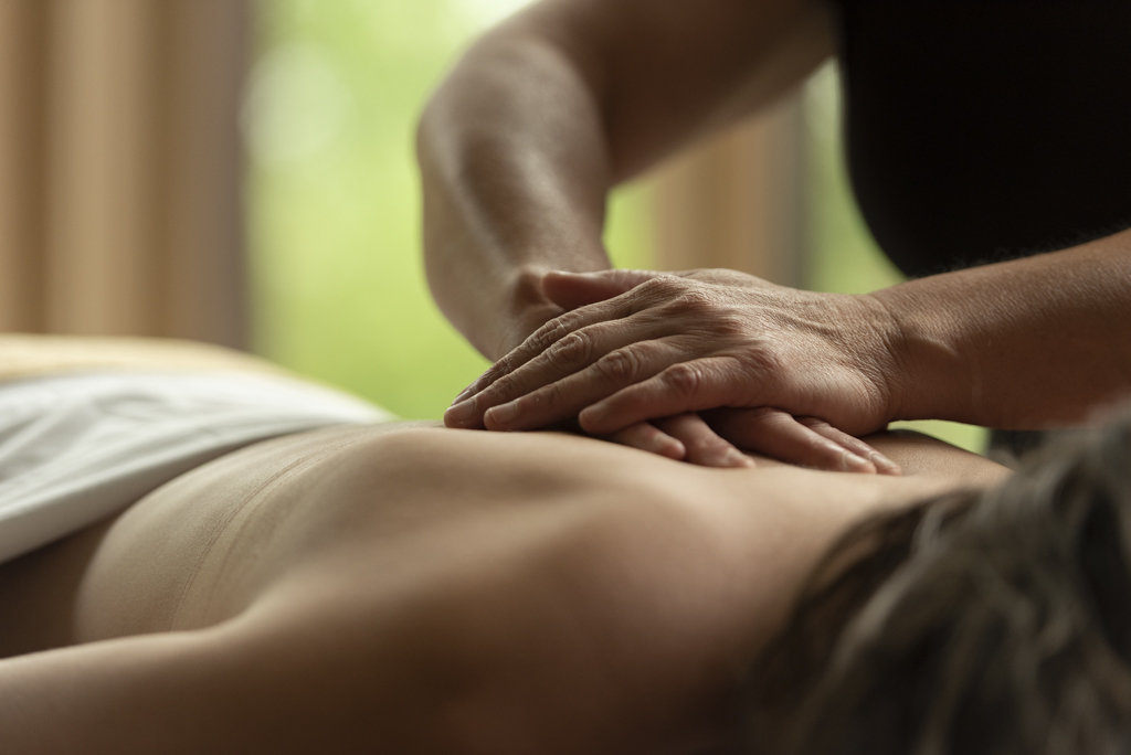 Woman giving a Massage to a person on their back at Scandinave Spa Blue Mountain.